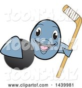 Vector Illustration of a Cartoon Porpoise Dolphin School Mascot Grabbing a Hockey Puck and Holding a Stick by Toons4Biz