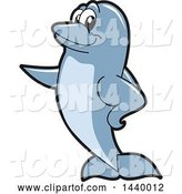 Vector Illustration of a Cartoon Porpoise Dolphin School Mascot Pointing by Toons4Biz