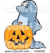 Vector Illustration of a Cartoon Porpoise Dolphin School Mascot with a Halloween Jackolantern Pumpkin by Toons4Biz