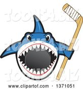 Vector Illustration of a Cartoon Shark School Mascot Biting a Hockey Puck and Holding a Stick by Toons4Biz