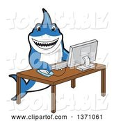 Vector Illustration of a Cartoon Shark School Mascot Using a Desktop Computer by Toons4Biz