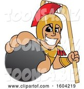 Vector Illustration of a Cartoon Spartan Warrior Mascot Holding a Hockey Puck and Stick by Toons4Biz