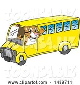 Vector Illustration of a Cartoon Tiger Cub Mascot Driving a School Bus by Toons4Biz