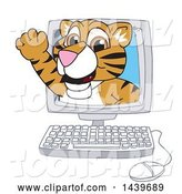 Vector Illustration of a Cartoon Tiger Cub Mascot Emerging from a Computer Screen by Toons4Biz