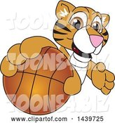 Vector Illustration of a Cartoon Tiger Cub Mascot Grabbing a Basketball by Toons4Biz