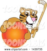 Vector Illustration of a Cartoon Tiger Cub Mascot Grabbing a Hockey Ball and Holding a Stick by Toons4Biz