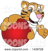 Vector Illustration of a Cartoon Tiger Cub Mascot Grabbing a Red Ball by Toons4Biz