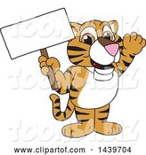 Vector Illustration of a Cartoon Tiger Cub Mascot Holding a Blank Sign by Toons4Biz