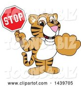 Vector Illustration of a Cartoon Tiger Cub Mascot Holding a Stop Sign by Toons4Biz