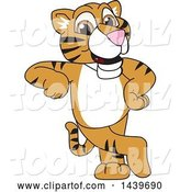 Vector Illustration of a Cartoon Tiger Cub Mascot Leaning by Toons4Biz