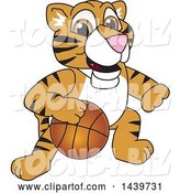Vector Illustration of a Cartoon Tiger Cub Mascot Playing Basketball by Toons4Biz