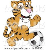Vector Illustration of a Cartoon Tiger Cub Mascot Playing Soccer by Toons4Biz