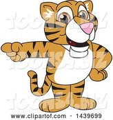 Vector Illustration of a Cartoon Tiger Cub Mascot Pointing by Toons4Biz
