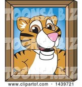 Vector Illustration of a Cartoon Tiger Cub Mascot Portrait by Toons4Biz