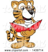 Vector Illustration of a Cartoon Tiger Cub Mascot Reading a Book by Toons4Biz