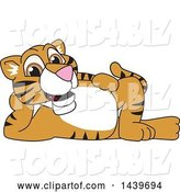 Vector Illustration of a Cartoon Tiger Cub Mascot Relaxing by Toons4Biz