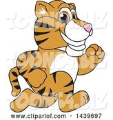 Vector Illustration of a Cartoon Tiger Cub Mascot Running by Toons4Biz
