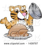 Vector Illustration of a Cartoon Tiger Cub Mascot Serving a Thanksgiving Turkey by Toons4Biz