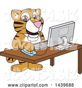 Vector Illustration of a Cartoon Tiger Cub Mascot Using a Computer by Toons4Biz