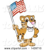 Vector Illustration of a Cartoon Tiger Cub Mascot Waving an American Flag by Toons4Biz