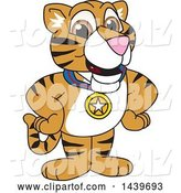 Vector Illustration of a Cartoon Tiger Cub Mascot Wearing a Sports Medal by Toons4Biz
