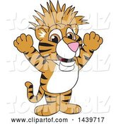 Vector Illustration of a Cartoon Tiger Cub Mascot with a Mohawk by Toons4Biz