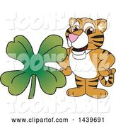 Vector Illustration of a Cartoon Tiger Cub Mascot with a St Patricks Day Clover by Toons4Biz