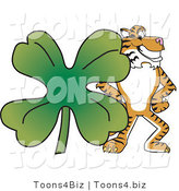 Vector Illustration of a Cartoon Tiger Mascot with a Clover by Toons4Biz