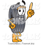 Vector Illustration of a Cartoon Tire Mascot Pointing Upwards by Toons4Biz