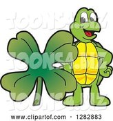 Vector Illustration of a Cartoon Turtle Mascot with a St Patricks Day Four Leaf Clover Shamrock by Toons4Biz