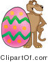Vector Illustration of a Cartoon Cougar Mascot Character with an Easter Egg by Toons4Biz