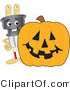Vector Illustration of a Cartoon Electric Plug Mascot with a Halloween Pumpkin by Toons4Biz